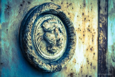 Ouroboros on a cemetery door